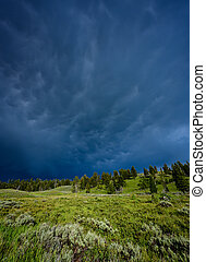 Dark and stormy clouds over Green hills
