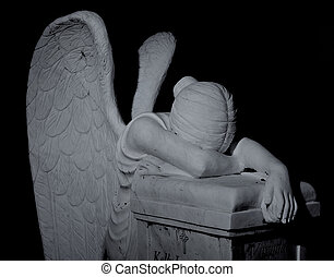 Dark Angel - Cemetary headstone of a winged angel weeping...