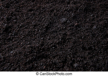 dark background with top soil - flower or potting soil for...