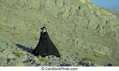 Dark beautiful lady in the mountains