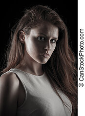 Dark beauty portrait of a young caucasian woman