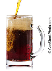 Dark beer pouring into glass