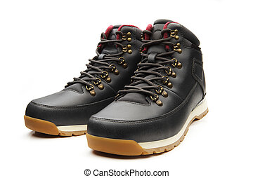 Dark black boots with shoelace on white background.