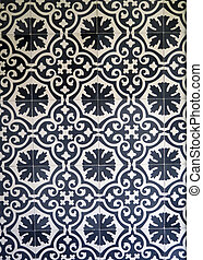 Dark blue and white ceramic tiles on wall in village in Andalusia