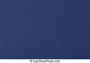Dark blue colored felt texture background on macro.