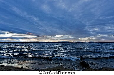 dark blue evening cloudy watercolor sky over the lake
