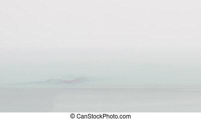 dark blue ink drop in water in 180fps slow motion
