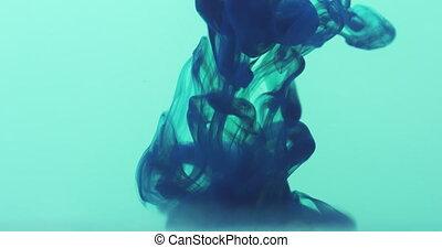 dark blue ink poured in blue water in 60fps slow motion