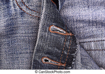 Dark blue jeans close up, denim cloth texture background