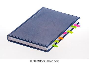 Dark blue notebook and bookmarks