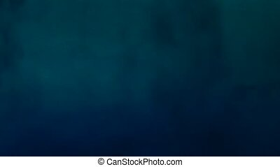Dark blue powder in liquid. Abstract background.