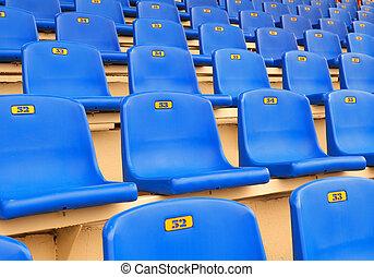 Dark blue seats on a sports tribune