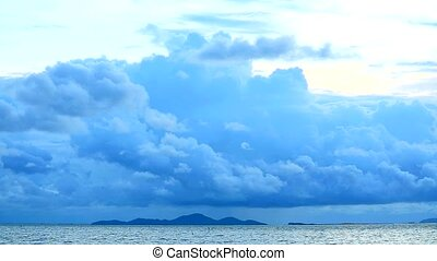 dark blue sky and heap storm cloud rolling by the wind over sea time lapse