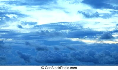 dark blue sky and heap storm cloud rolling by the wind time lapse