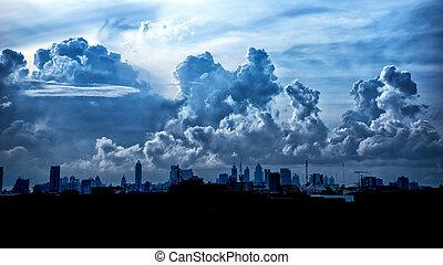 Dark blue storm clouds over city in rainy season