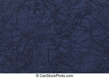 Dark blue wavy background from a textile material. Fabric with natural texture clousup.