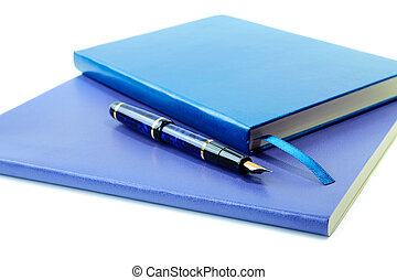 Dark blue writing-books and fountain pen isolated on a white