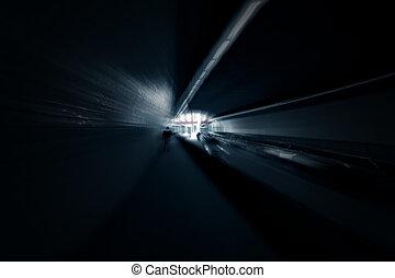 Dark blurred blue tunnel