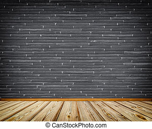 Dark brick wall and wooden floor.