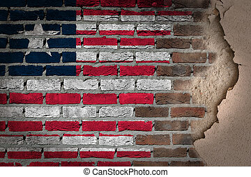 Dark brick wall with plaster - Liberia - Dark brick wall...