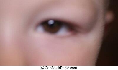 dark brown eye of a little child close-up