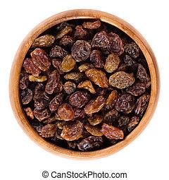 Dark brown raisins in wooden bowl over white - Raisins in ...