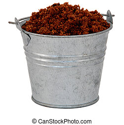 Dark brown soft / muscovado sugar in a miniature metal bucket