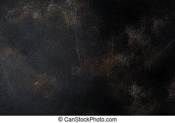 Dark brown stone or slate wall. Grunge texture background.