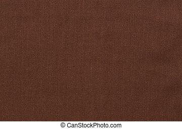 Dark brown textile background.