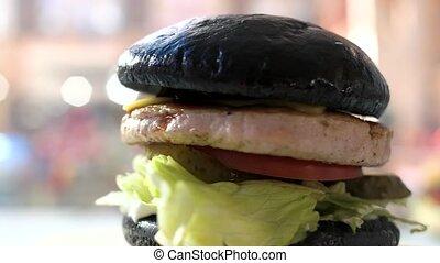 Dark bun hamburger. Lettuce leaves, meat and sauce. Finest...