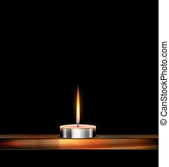 dark, burning candle and wood - dark background and burning...