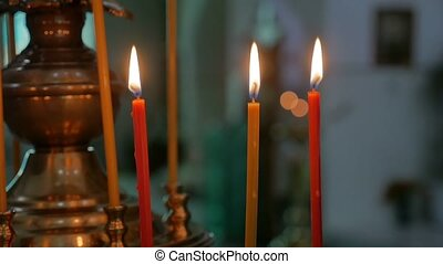 dark candles in russian church orthodox of service sacrament indoors slow motion video