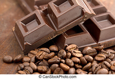 dark chocolate and pile of coffee beans