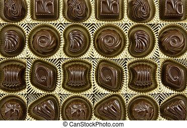 dark chocolate pralines in a golden box