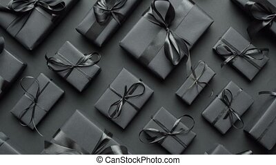 Dark Christmas theme. Square boxed gifts wrapped in black ...
