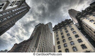 Dark Clouds above Skyscraper - HDR Timelapse of Skyscraper...