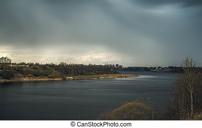 dark clouds before rain on the river