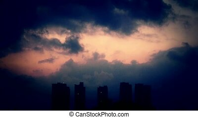 Dark clouds cover sky at evening, building high-rise, House silhouette.
