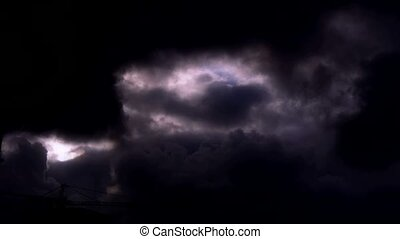 Dark clouds cover sky at night