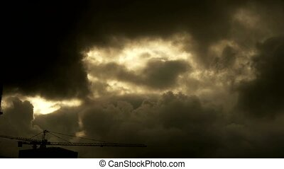 Dark clouds cover sky,Cranes,building high-rise,House...