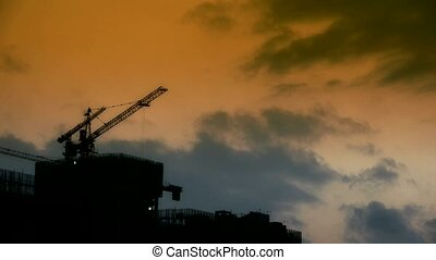 Dark clouds cover sun sky,building