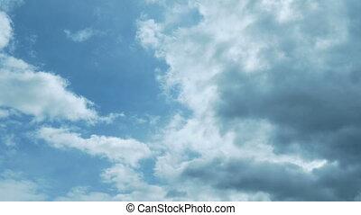 Dark Clouds Move Across Blue Sky - Big mass of dark cloud...