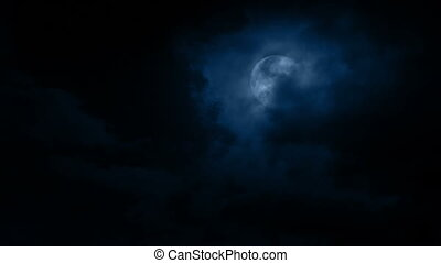 Dark Clouds Move Over The Moon - Night sky with large clouds...