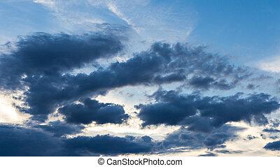 Dark clouds on blue sky background