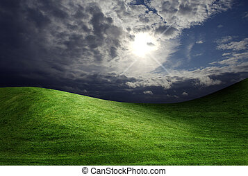 dark cloudy sky and green grass