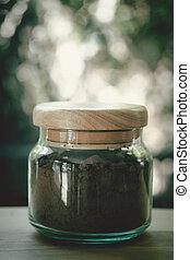 Dark cocoa powder in glass jar