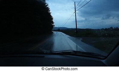 Dark corner. Wet road.