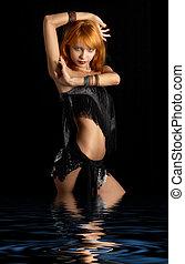 dark dance - lovely redhead dancing in the dark water