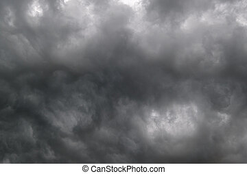 Dark dramatic cloudy overcast sky with thunderstorm clouds