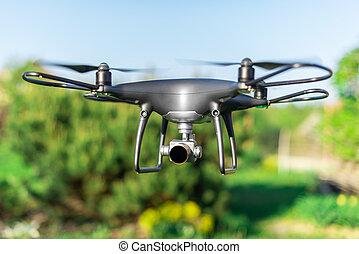 Dark drone flying through the air.